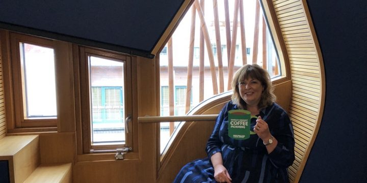 Local MSP Fiona Hyslop Raises a Mug in Support of Macmillan's Coffee Morning